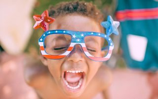 Child Wearing 4th of July Glasses